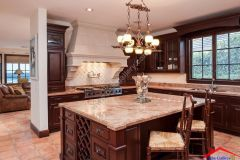 traditional kitchen with breakfast Bar And stone backsplash I G IS5il67965egcz0000000000 WHpkO